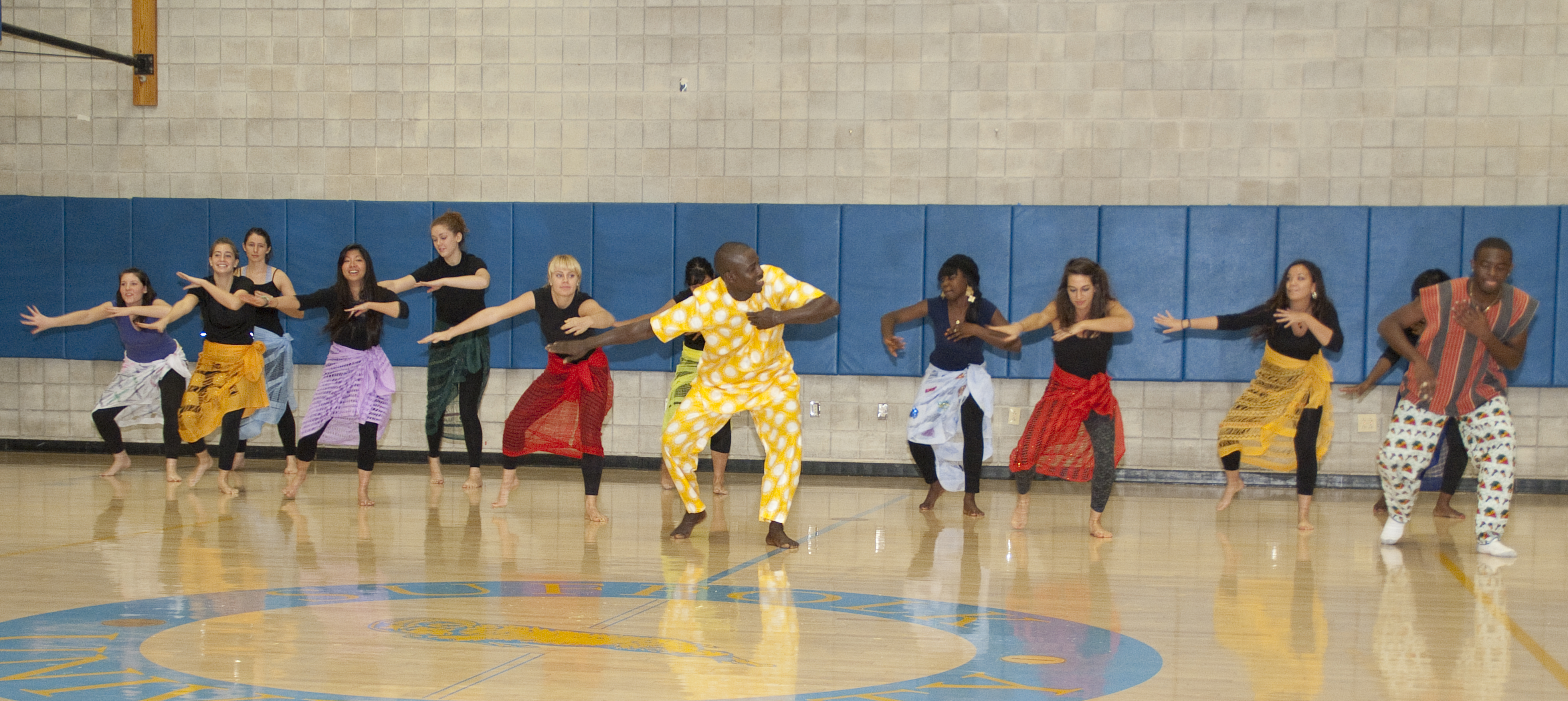 Aziz leads the dancers from the dance class.