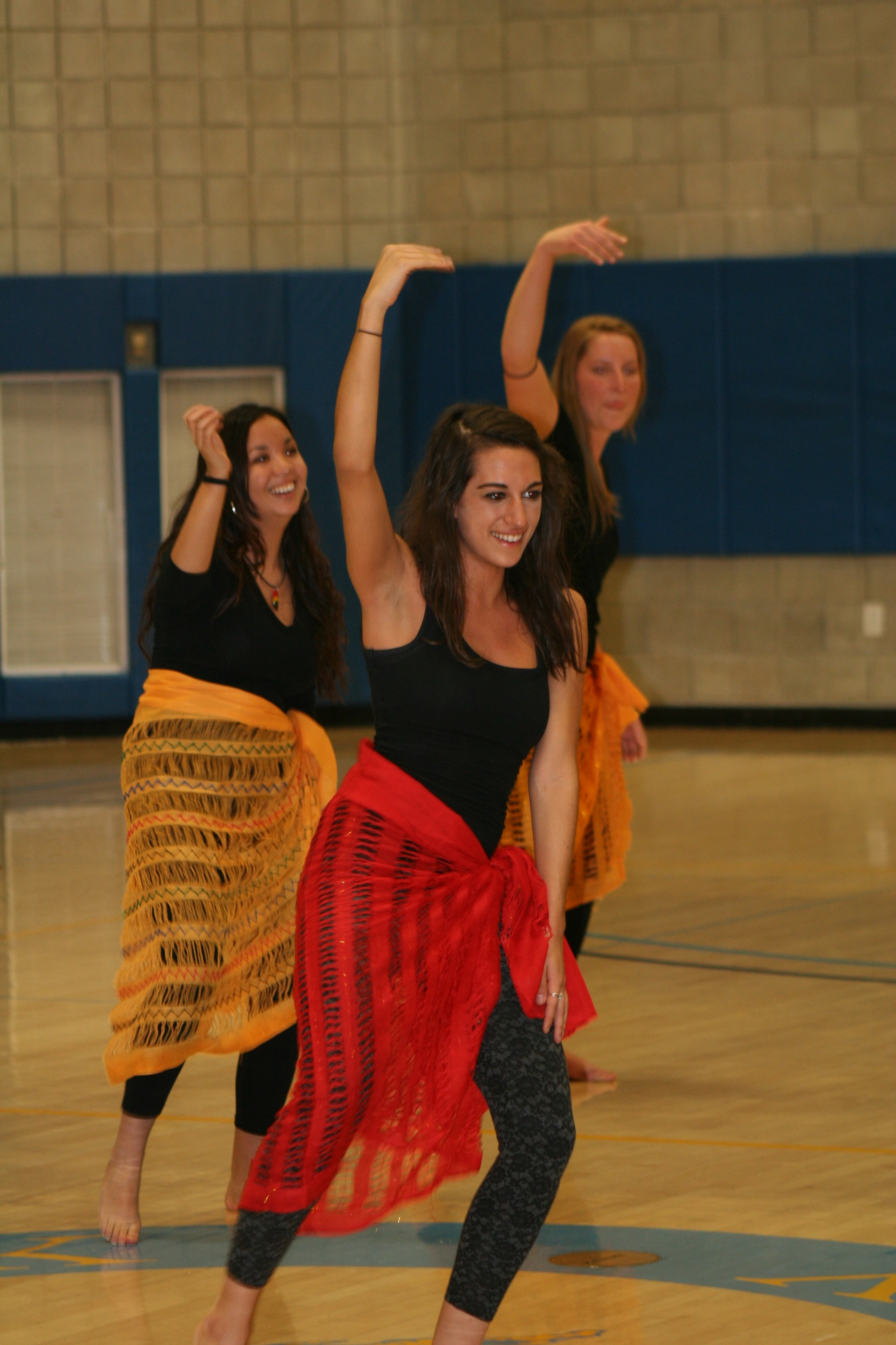 Students dance to the rhythms.
