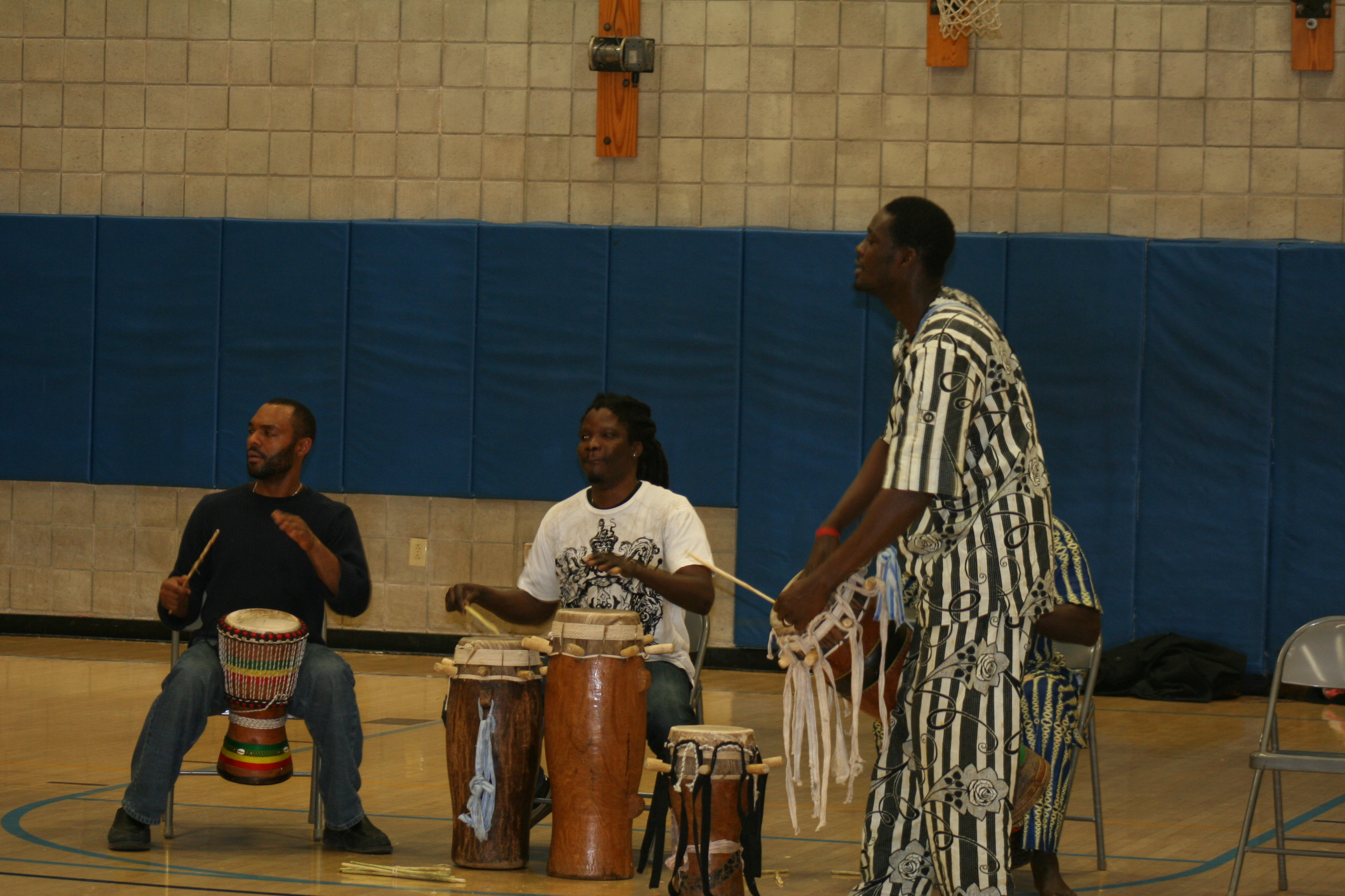 Lamine Toure joins the drummers.