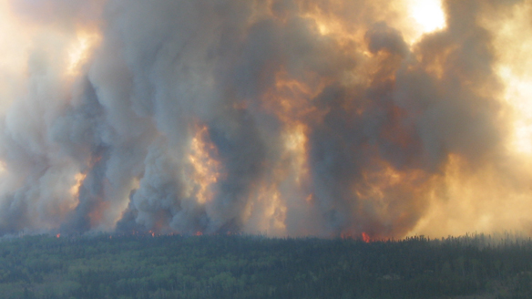 Billowing smoke from the fire forced the province to airlift 55 people from the community on Wednesday night.