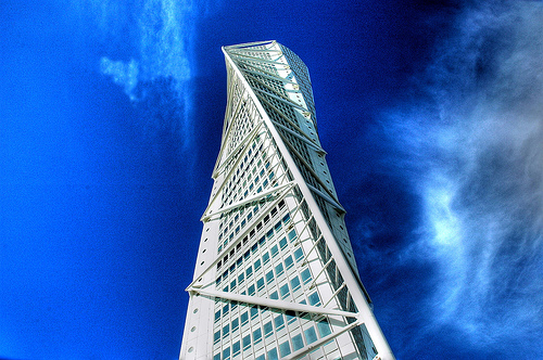 Constructing tables is an art - maximizing readability and information can be challenging. The image is of the Turning Torso in Malmö and is CC by Alan Lam.