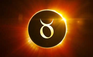 solar eclipse with taurus zodiac symbol