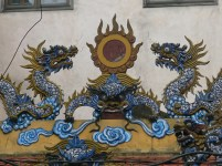 Dragons and sun temple on a rooftop