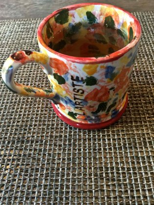 I drink green tea from a mug Nelli painted for me my last trip there.