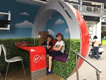 Theo and Julian in a Virgin pod.