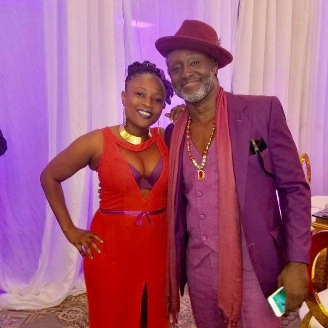 Reggie Rockstone with wife at Sarkodie and Tracy's white wedding held at Labadi Beach Hotel in Accra on Saturday, July 21.