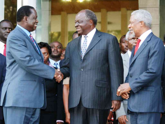 Former UN secretary general Kofi Anan watches as Opposition leader Raila Odinga and President Mwai Kibaki shake hands outside Harambee House, after brokering a peace deal in 2008 following post-election violence