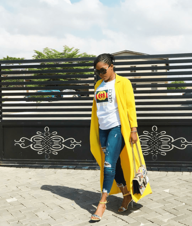 Mzbel served a look in this Gucci tee over denim and a long coat