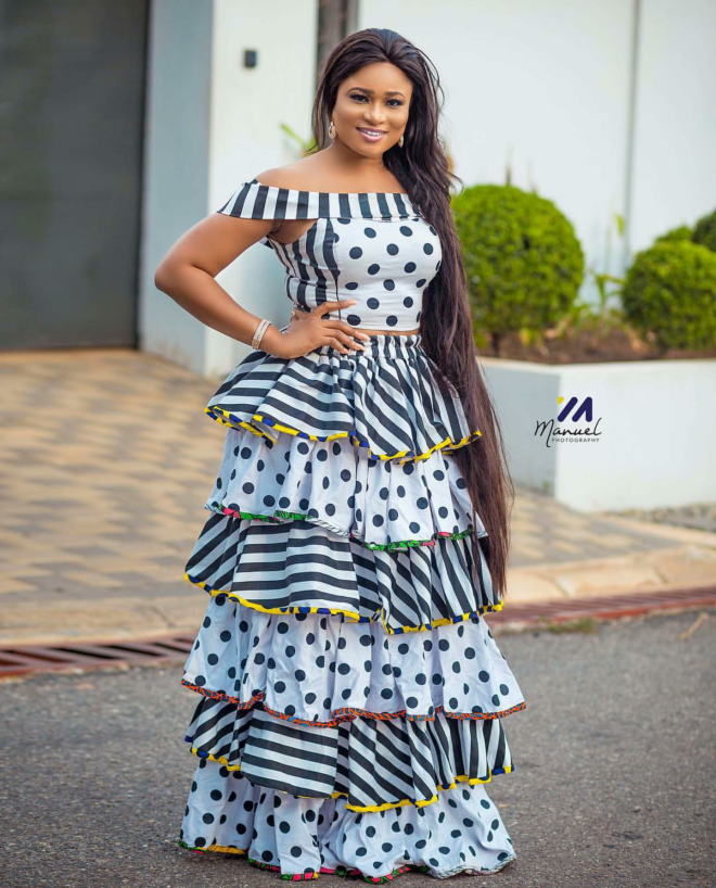Christabel Ekeh served style goals in this two piece polka dots and stripes top and raffled skirt