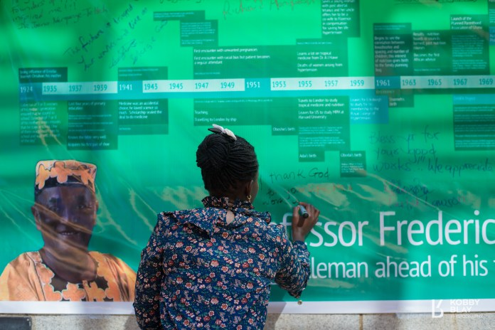 A participant leaves her message on the banner timeline of Prof Sai during the relaunching of the Fred T Sai Institute in Accra