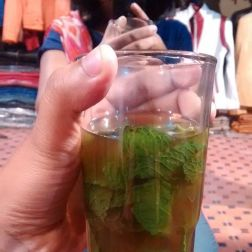 You are offered a glass of tea while shopping
