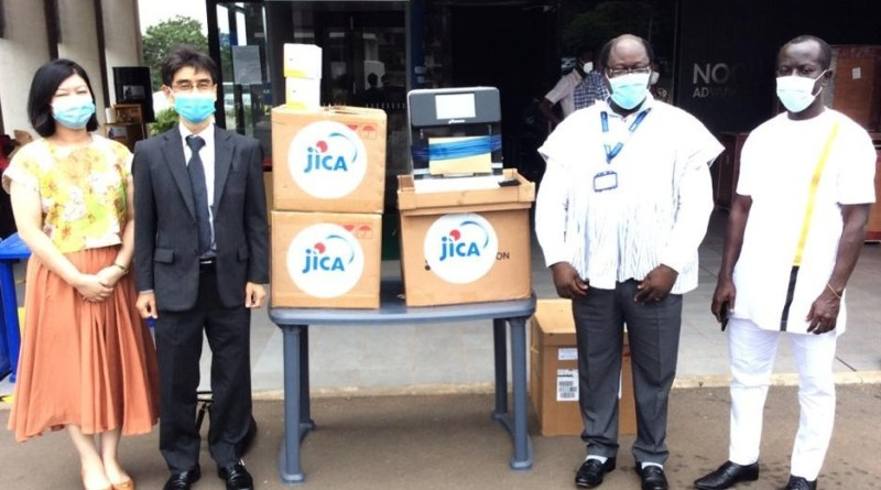 Handover ceremony for the automated RNA extraction machine and extraction kits, in front of Advanced Research Laboratories at Noguchi Memorial Institute for Medical Research.