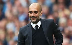 Pep Guardiola signs new two-year deal