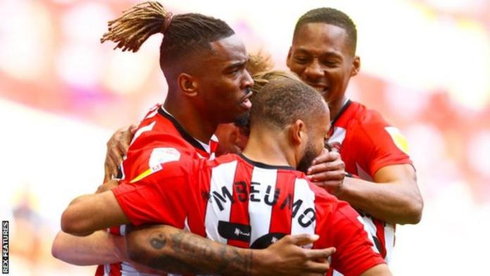 Brentford beats Dede Ayew's Swansea to qualify for Premiership for first time