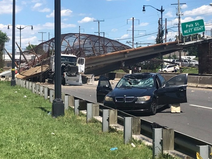 5 people hospitalised after pedestrian bridge collapses onto DC highway