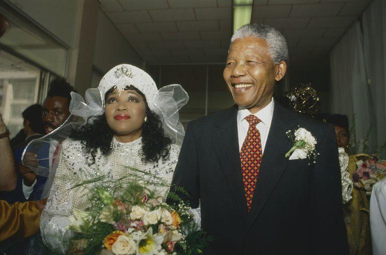 Nelson Mandela escorts Zindzi Mandela on her wedding day.