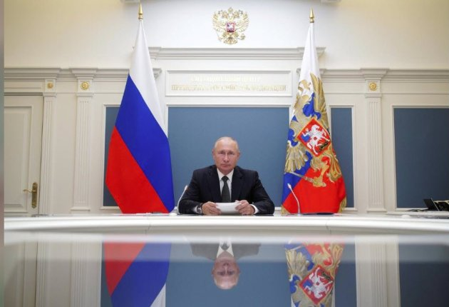 Russian President Vladimir Putin takes part in a video conference call, dedicated to the opening of new military medical centres for patients infected with the coronavirus disease. Image / Babushkin/Kremlin (REUTERS)
