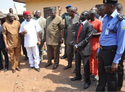 Gov. Ifeanyi Ugwuanyi  flanked by Chief Dubem Onyia, Mr. Chime Oji (left) and the Chief of Staff, Government House, Enugu, Sir Victor Atuonwu (right), during a visit to the site where Ozongwu was murdered.