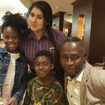 PHOTOS: Obiba Sly Collins shows off his family on trip to UK