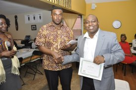 GhanaProNet CEO Stephen Abebreseh presenting Eric Otoo with a certificate of honor...