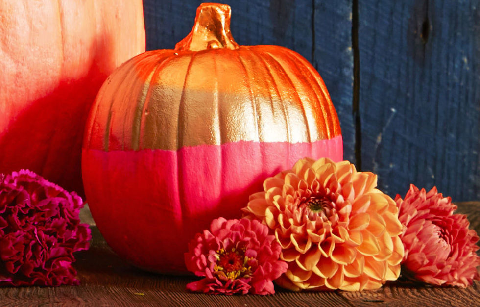 Play with neon hues and metallics for a two-tone pumpkin that makes a bright statement. Brush or dip one half and let dry. Then tape off and color the other half.