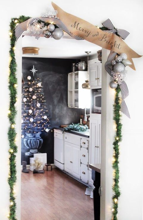My favorite DIY Christmas Decor. DIY Christmas Decor Ideas. This blogger got into the spirit by drawing up a beautiful Christmas tree on her chalkboard wall (and we love her door-frame garland, too!). See more at Hunted Interior »