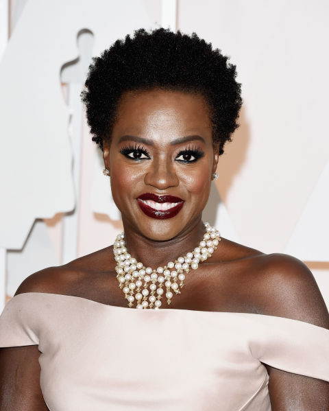 If you love to show off your makeup and jewelry and your hair is very curly, try Viola Davis's close crop for a sophisticated 'do that works with any outfit.