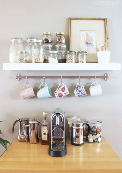 When you combine a floating shelf with a silver rail and S-hooks, you have a coffee station that feels almost like a brand-new piece of furniture.  See more at The Inspired Room »