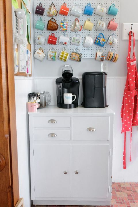 The best thing about pegboard organization is you can rearrange your holder when the look starts to get boring. Here, mugs are hung in a straight row, but it can easily be updated if you decide you want a more laid-back style.  See more at A Study in Contrasts »
