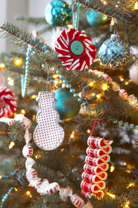 A red-and-white theme inspired this quartet of decorations. Use actual candy to create edible garlands and a crimped ornament, or copy the color palette on cookie-cutters and Christmas rosettes. Get the tutorial » What you'll need: peppermints ($17 for 5 pounds, amazon.com), ribbon candy ornament ($10, etsy.com)