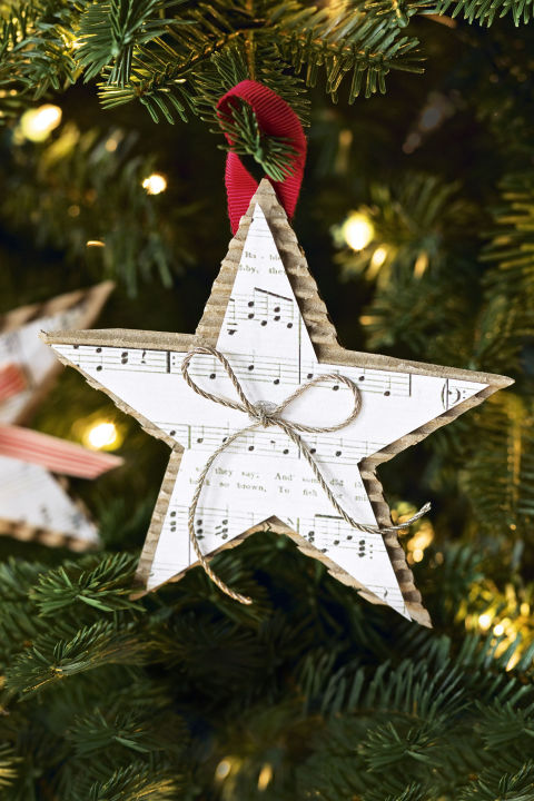 Show off your favorite holiday tune by displaying the sheet music in the form of a star. Place a small bow in the middle for an added accent. Get the tutorial » What you'll need:brown cardboard ($15 for 50, amazon.com), twine ($7, amazon.com), sheet music ($10, amazon.com)