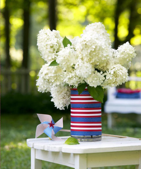 All-white flowers like hydrangeas seem instantly all-American when presented in a vase that evokes the stars and stripes. Measure the vase's circumference, then cut lengths of patriotic ribbon to size. Attach with double-sided tape to cover the vase.