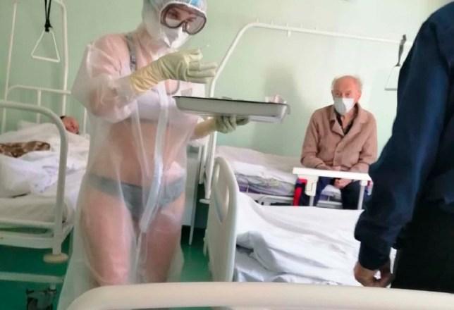 Russia: Nurse reprimanded for wearing bikini under transparent PPE