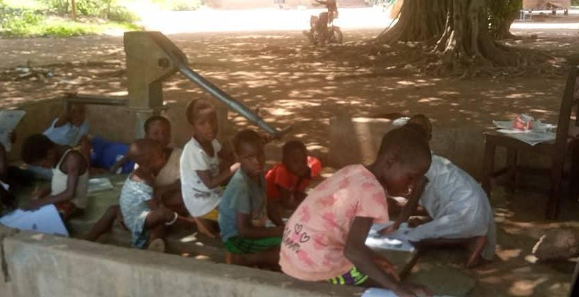Ofosu-Bator M/A Basic School pupils study under trees