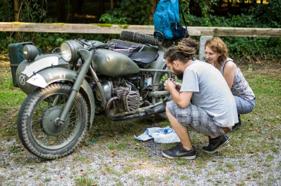 Hungarian Couple, checking an old Russian Ural Motorcycle (Austria)