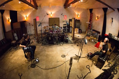 Clockwise from Left: Frank Bello, Charlie Benante, Scott Ian in the studio recording. Courtesy of Anthrax.com