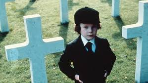 Damien in a cemetery