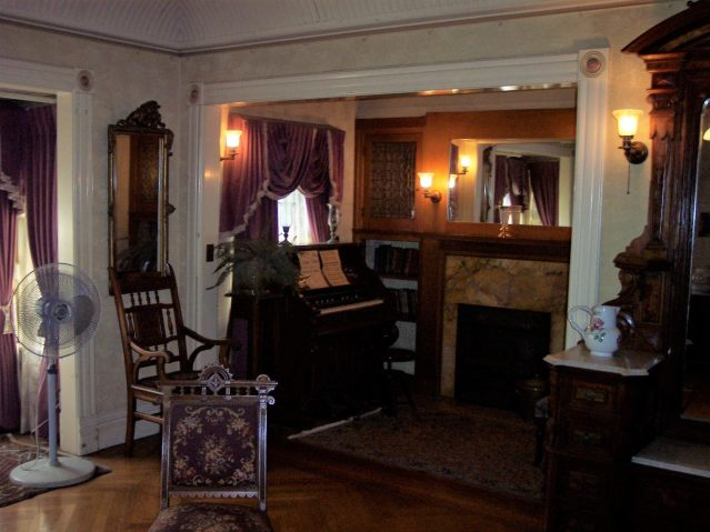 Inside of Winchester House with Chimney and Piano Photo Credit: Patrick Harrington