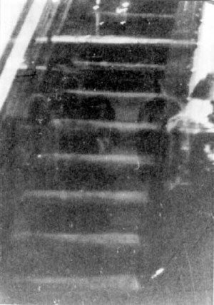 Famous image taken by Dale Kaczmarek in 1980 that shows monk-like ghosts floating down the Hull House staircase.