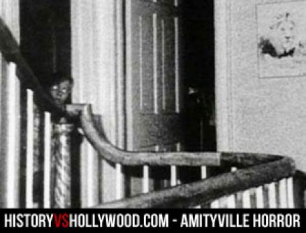 The alleged Amityville ghost peers out from a doorway on the second floor landing.