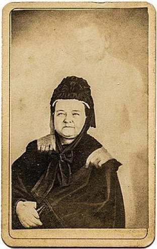 """Mary Todd Lincoln with the """"ghost"""" of her husband, in an image taken by spirit photographer William H. Mumler. Mumler's photos are now considered hoaxes."""