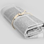 c. rolled newspaper, showing lessons learned in life from early teachings