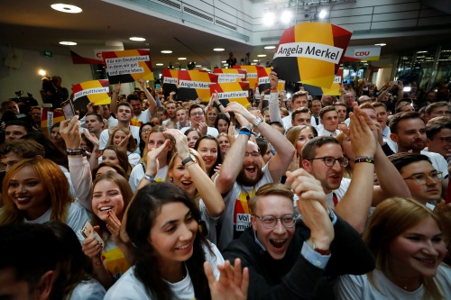 People at the Christian Democratic Union CDU headquarters react on first exit polls in the German general election (Bundestagswahl) in Berlin, Germany, September 24, 2017.