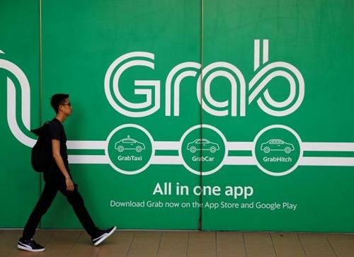 Bên ngoài văn phòng của Grab tại Singapore. Ảnh: Reutes