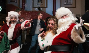 """DCU student Catherine Mackle pictured with SU Welfare Officer Eve Kerton and Santa Claus during the traditional SU Christmas Ball last Wednesday in the Hub. This year's theme was RTE's """"Toy Show""""."""