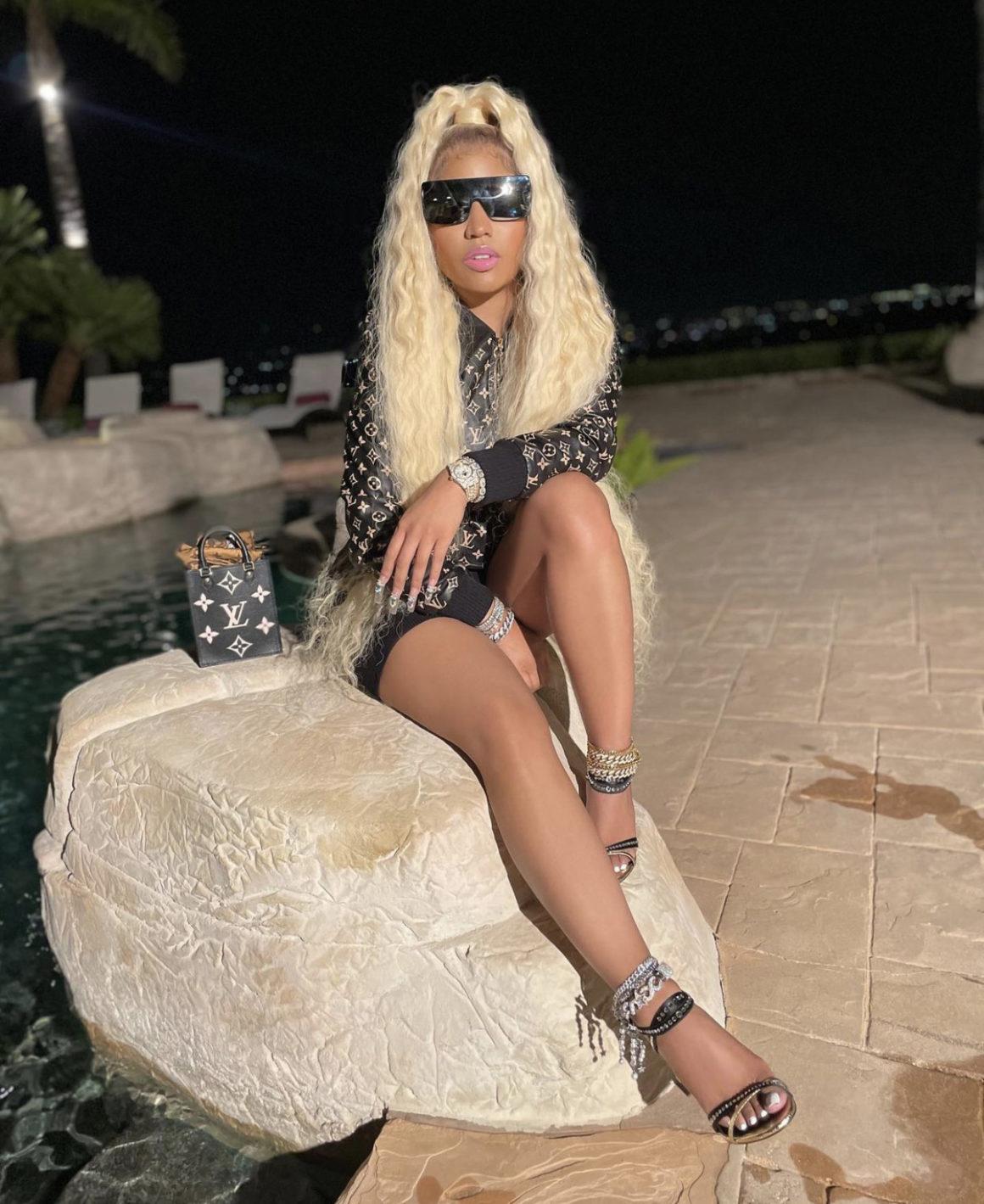 Nicki Minaj Promotes 'Whole Lotta Money' Remix Wearing Louis Vuitton Look Including Monogram Leather Bomber Jacket and Mini Monogram Handbag