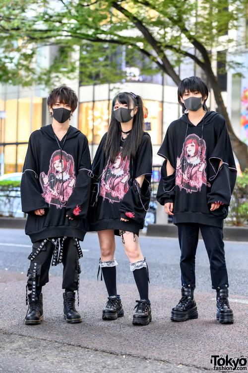 Yusuke, Akari, and L on the street in Harajuku wearing matching…
