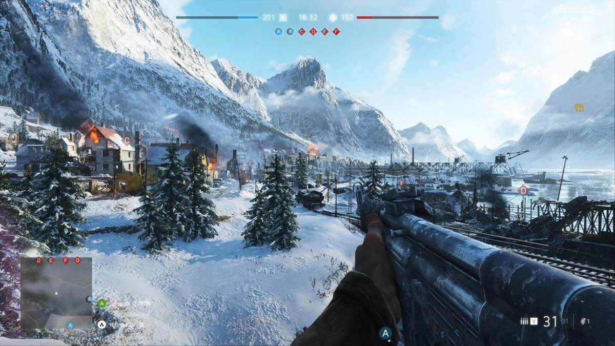 A soldier overlooks a snow covered town burning from battle.