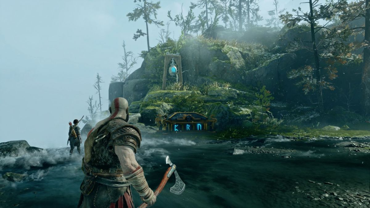 Kratos observes a runic puzzle atop a waterfall in God Of War