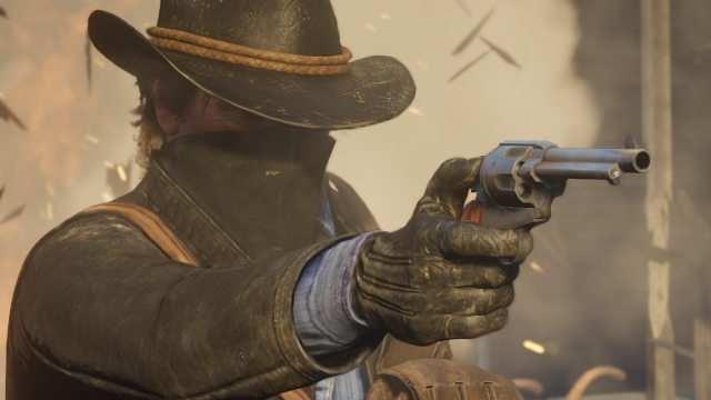 A cowboy has his face covered by a bandanna as he points his revolver.